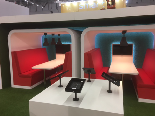 """Central iPads table and """"break-out"""" meeting booths"""